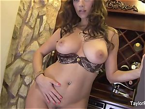 huge-titted black-haired Taylor Vixen taunts the camera
