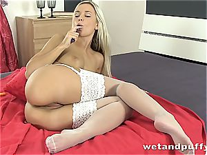 honey in white stocking touches herself with faux-cock