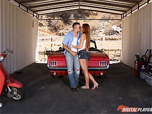 cool ginger-haired Farrah Flower humped up against a car