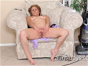 Cristine Ruby boinks herself with a enormous ebony dildo