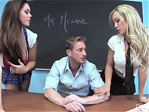 two mischievous college girls have fun with their educator
