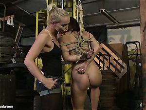 Kathia Nobili slapping the caboose of super hot dame with cane