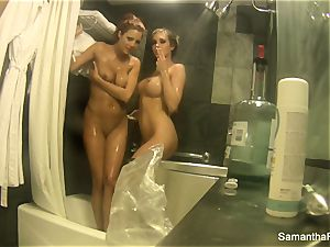 lesbo bathroom fun with Samantha Saint and Jayden Cole