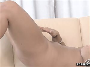 Daphne Klyde drains and plays with a faux-cock